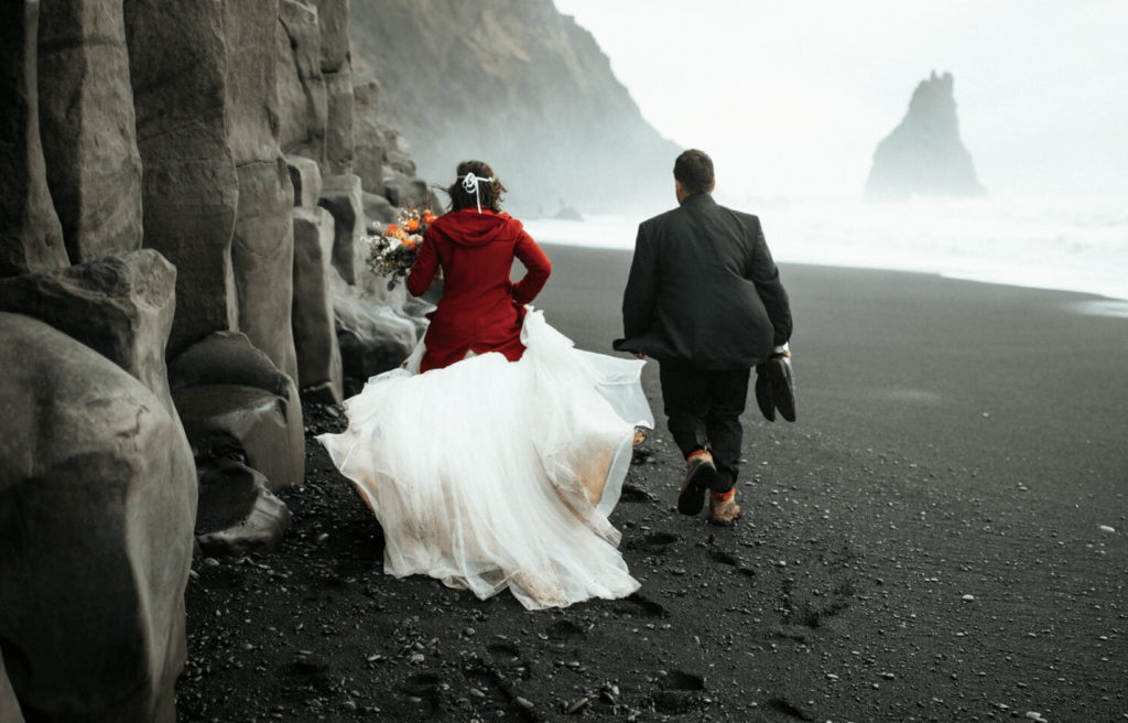 couple eloping on black sand beach in Iceland