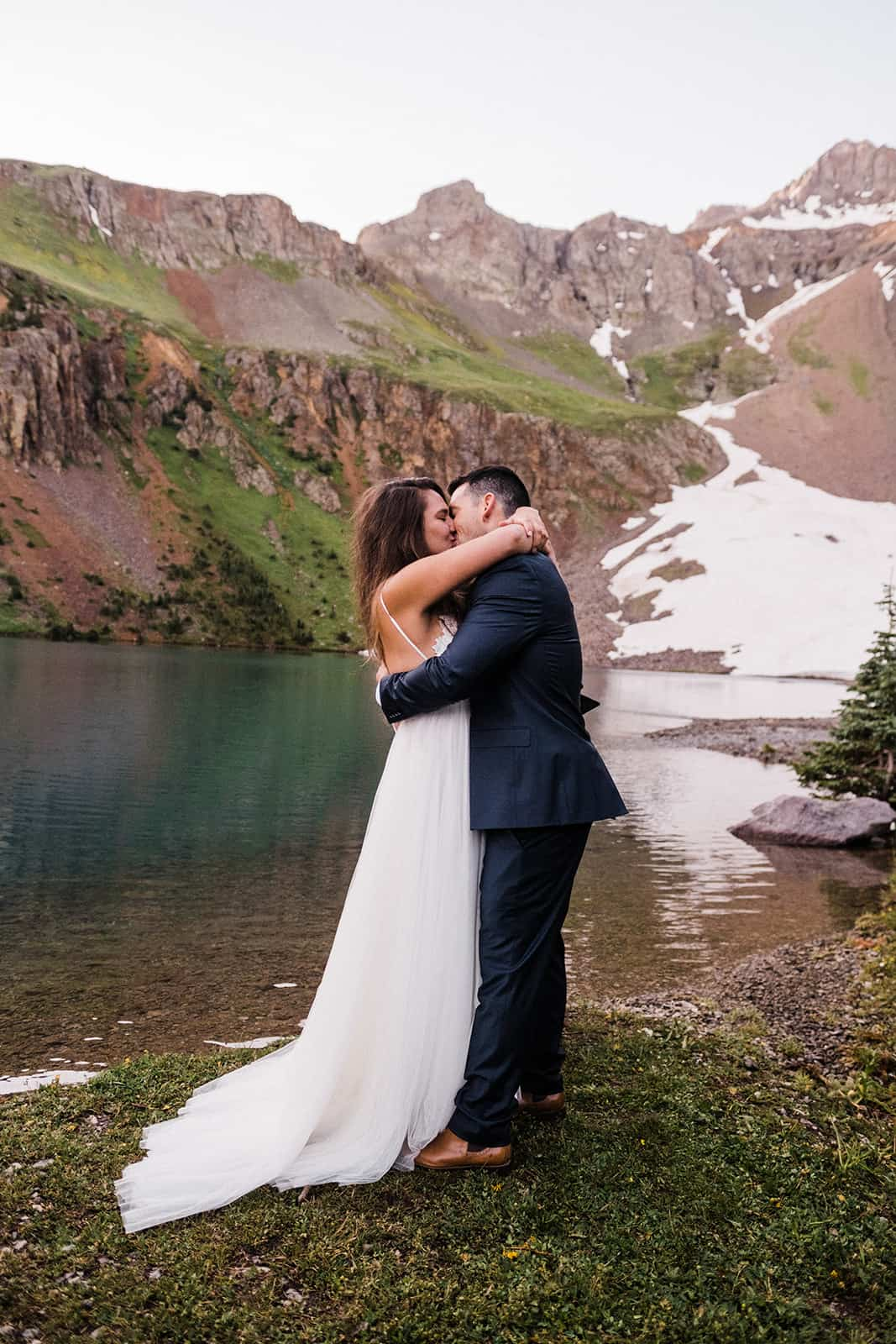 couple eloping next to blue lake in telluride colorado