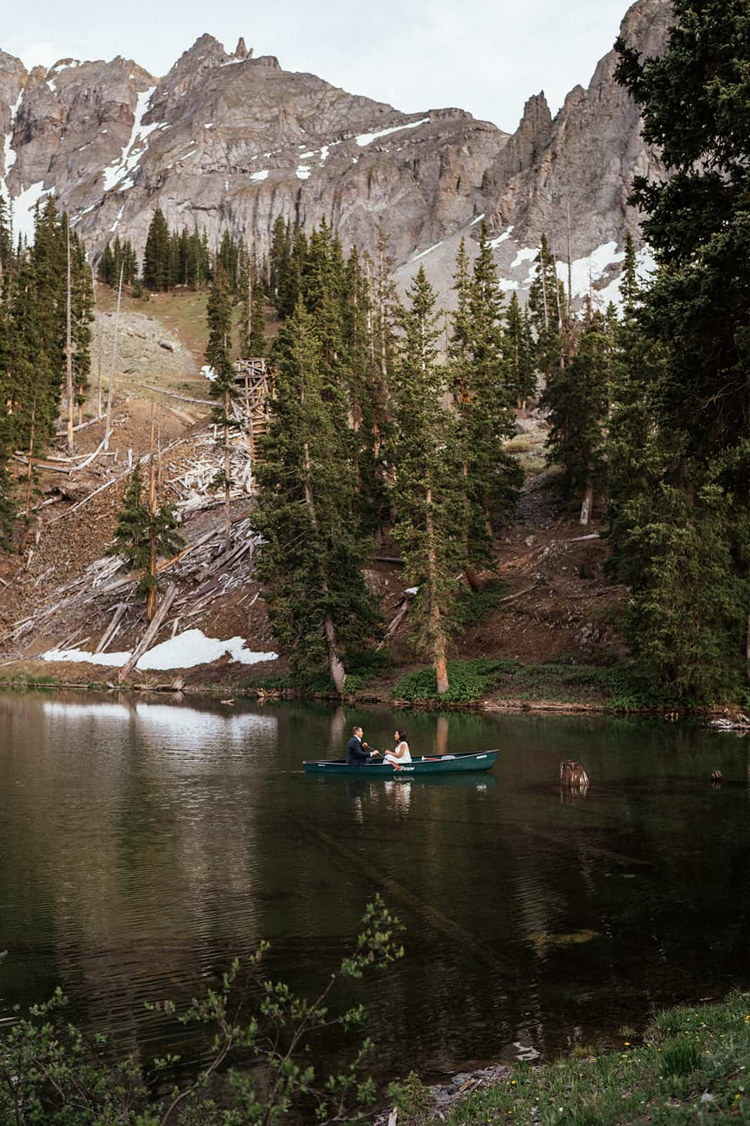 couple in canoe at Alta Lakes Observatory elopement near Telluride Colorado
