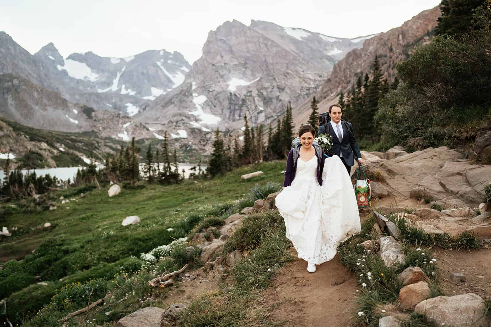 couple hiking at colorado elopement