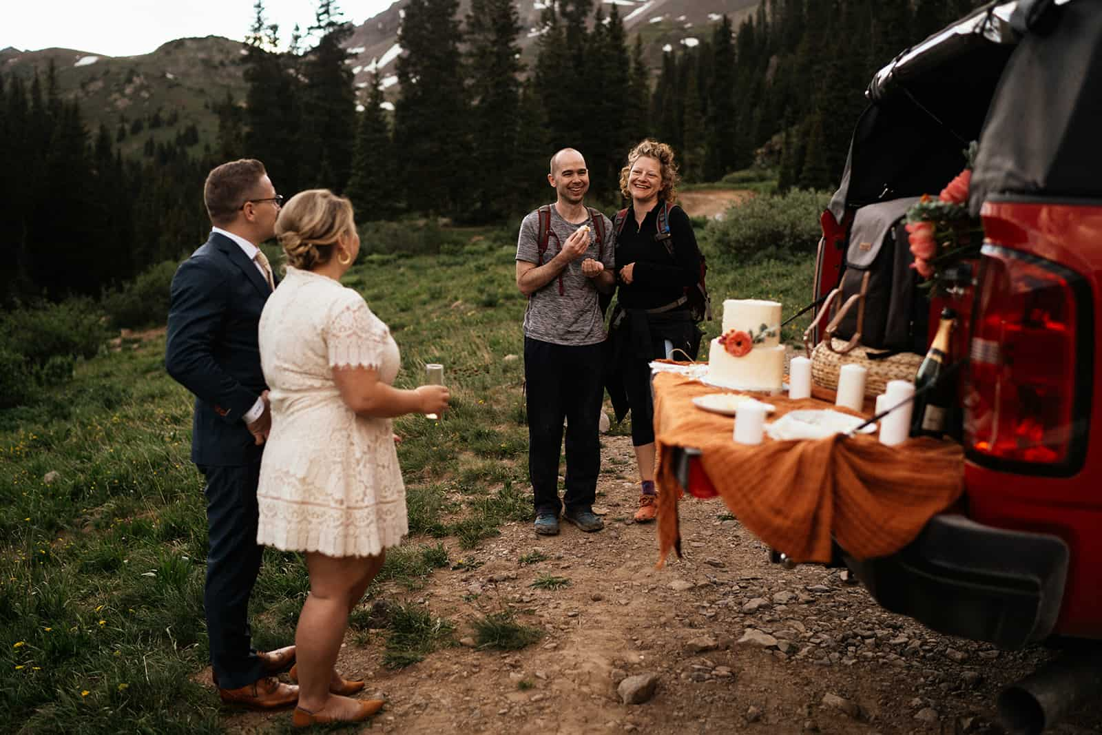 cutting the cake at colorado elopement