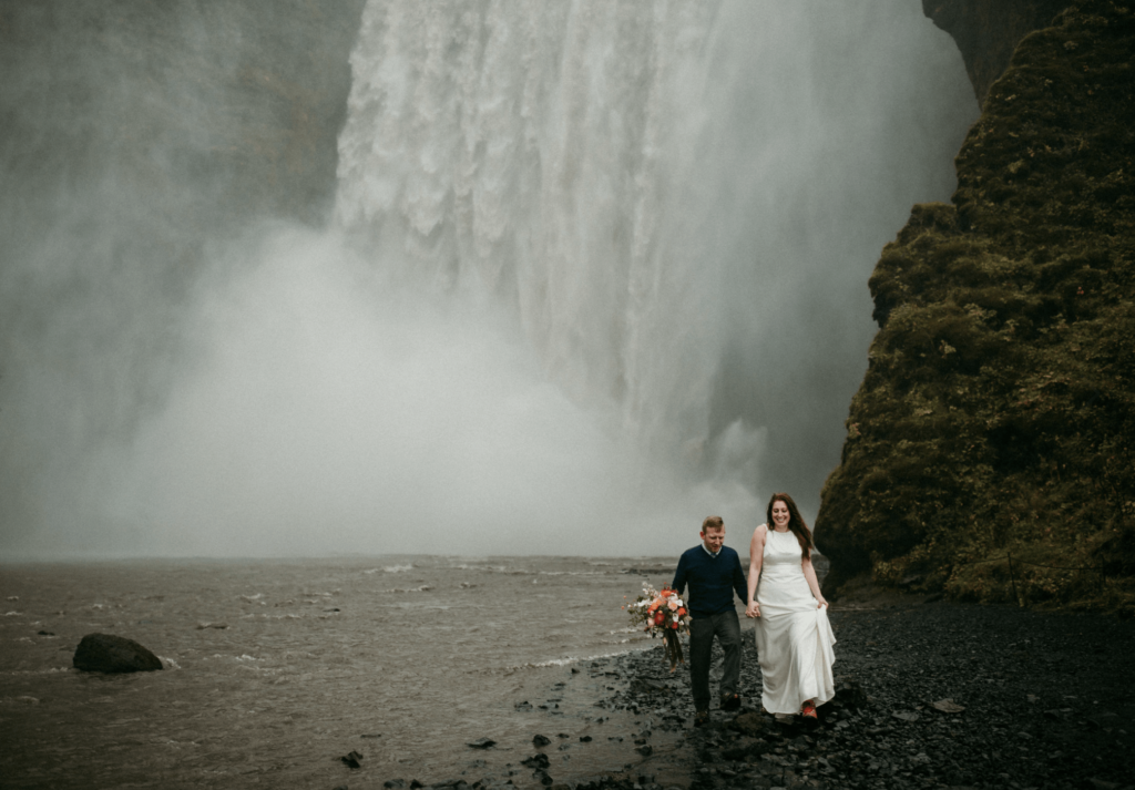 couple eloping at skogafoss in iceland
