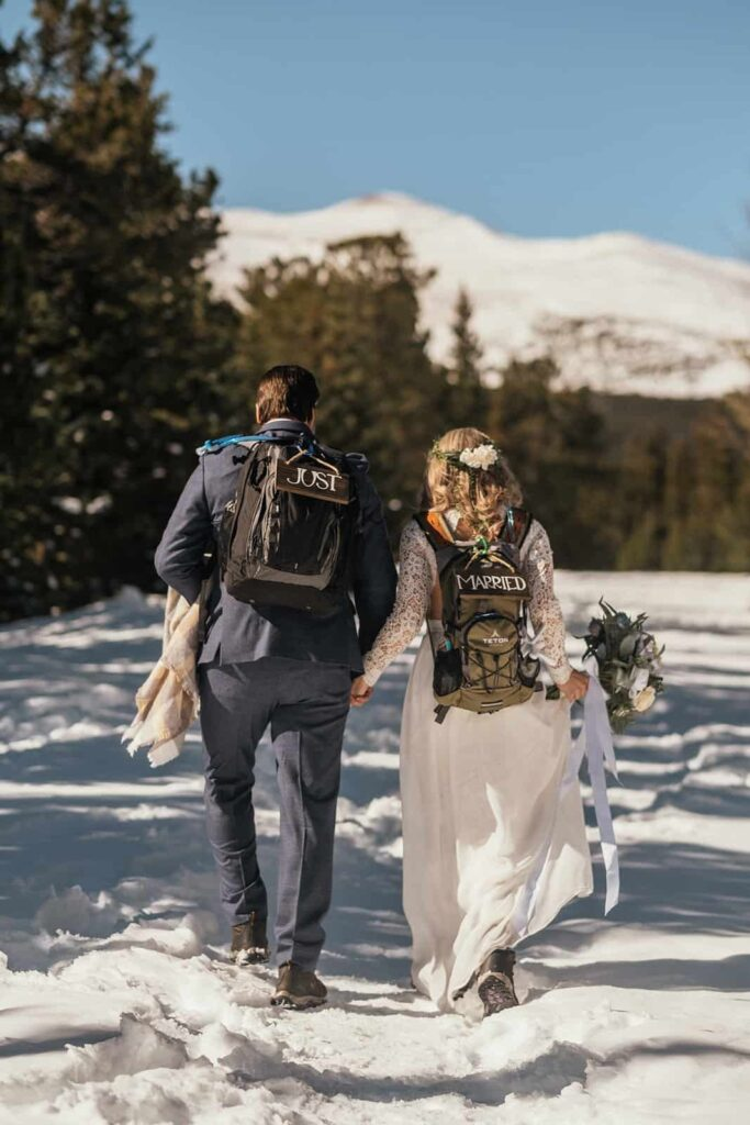 couple hiking at winter elopement in Colorado