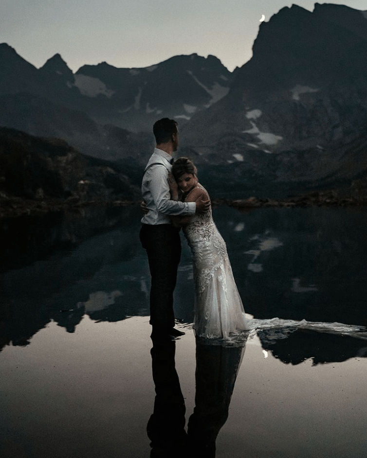 couple eloping at lake in Colorado mountains