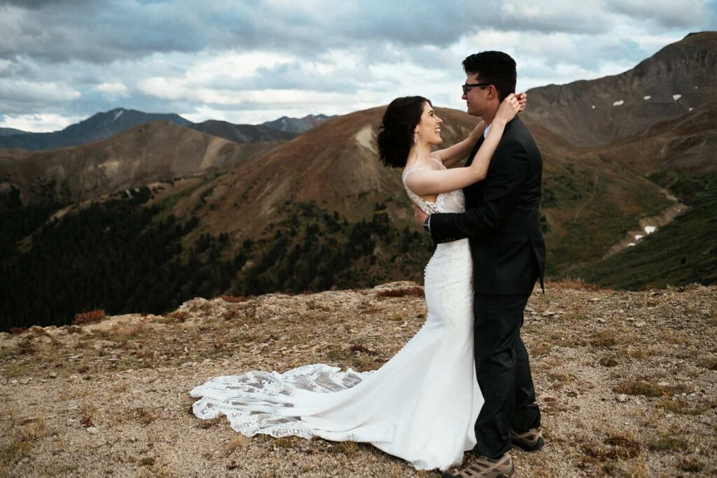couple dancing on top of mountain at elopement in Colorado