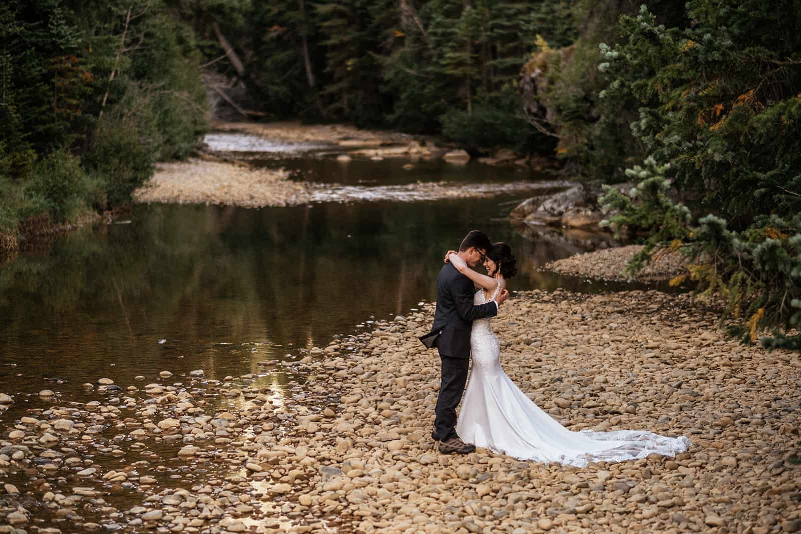 couple next to river at Colorado elopement